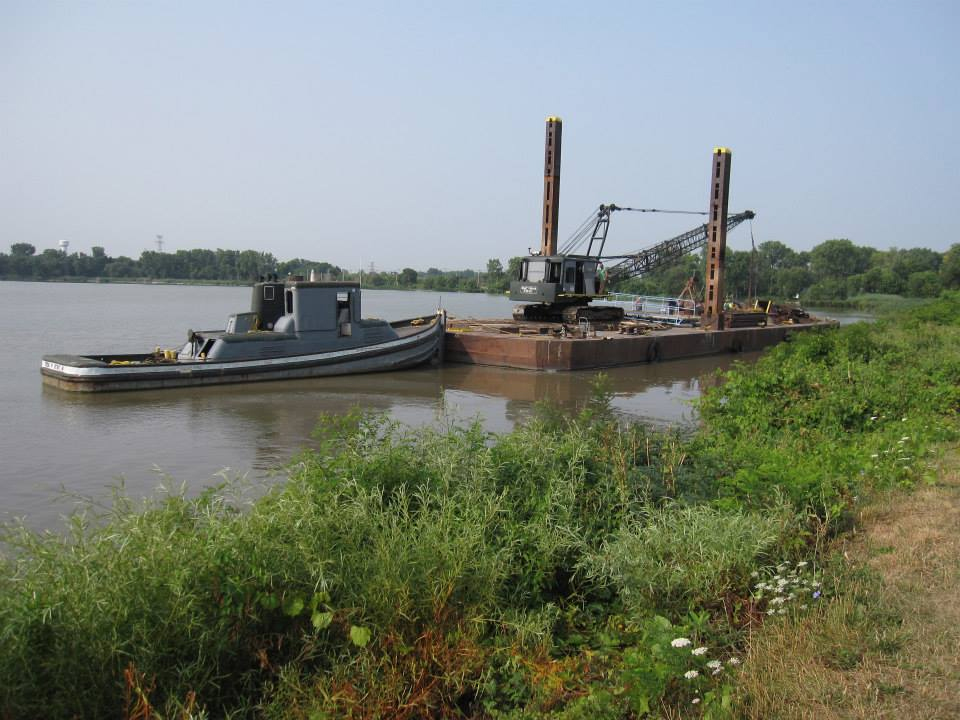 Tug pushing barge with deck